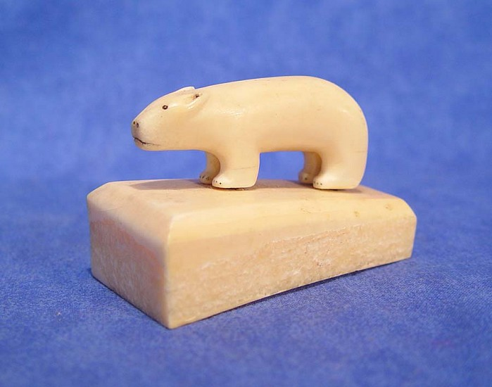 10 - Pacific Northwest, Fossil walrus ivory:  bear standing on ivory stand 1930