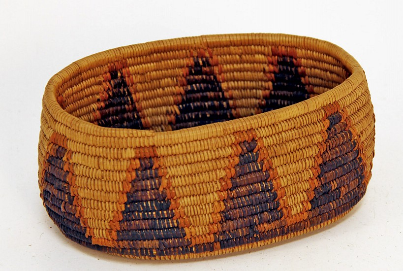 "02 - Indian Baskets, Antique Mission Basket: c. 1920 Cahuilla (Palm Spirings) Bowl, Oval (7.75"" x 4.5"" x 3.5"") c. 1920, Juncus, dyed juncus and sumac"