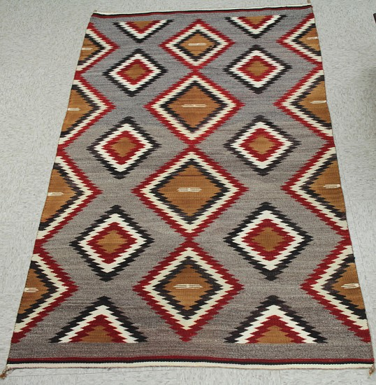 "01 - Navajo Textiles, Antique Navajo Rug: c. 1920s Eyedazzler, Banded Ends, Serrated Diamond Motif, Grey Field (43"" x 74"") Excellent condition c. 1920s, Handspun wool"